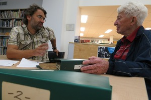 Leo and archivist Jeannot Bourdages discussing his collection (September 8, 2016; Photo by Glenn Patterson)